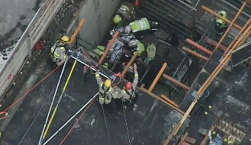 Emergency crews worked to free the man who fell more than 4 metres. (9NEWS)