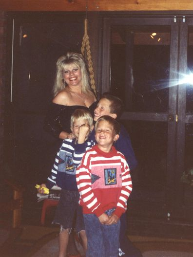 'Cheeky' Dan ruining yet another family photo.