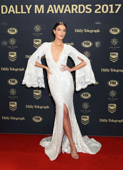 <p>Erin Holland in custom-made Pallas Couture</p>