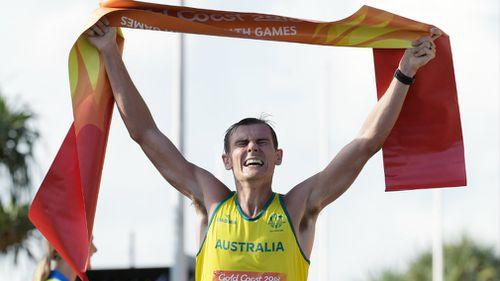 Dane Bird-Smith of Australia crosses the finish line to win the Men's 20km Race Walk final on day four. (AAP)