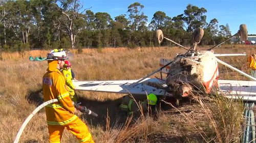 Fire crews doused the plane to prevent a small fire from spreading. (9NEWS)