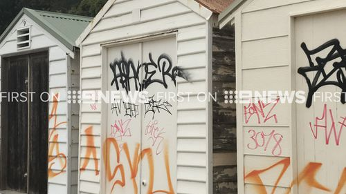 Eleven beach boxes at Point King Beach, Sorrento, have been tarnished by graffiti. (9NEWS)