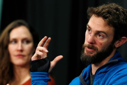 Travis Kauffman, right, with his girlfriend, Annie Bierbower, as they respond to questions during a news conference in Colorado.