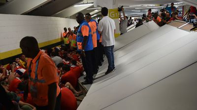 The Chile fans knocked over a partition during their rampage. (Getty)