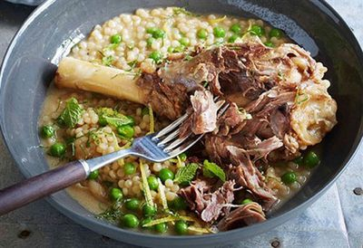 Braised lamb shanks with pearl cous cous, peas and mint