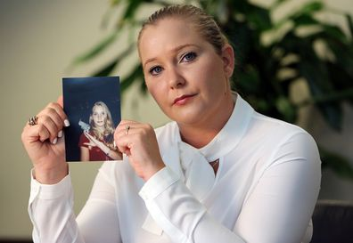 Virginia Roberts holds a photo of herself at age 16, when she says Palm Beach multimillionaire Jeffrey Epstein began abusing her sexually. (Emily Michot/Miami Herald/TNS/Sipa USA) .