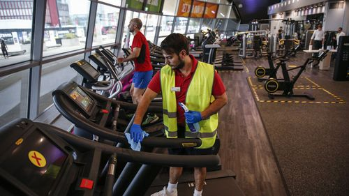 A worker disinfects a treadmill in the gym at London Aquatics Centre on July 25, 2020 in London, England