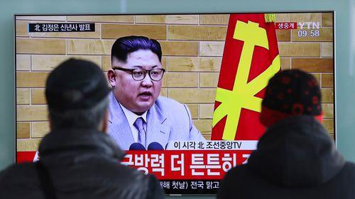 South Koreans watch a TV news program showing North Korean leader Kim Jong Un's New Year's speech on January 1, 2018. (AAP)
