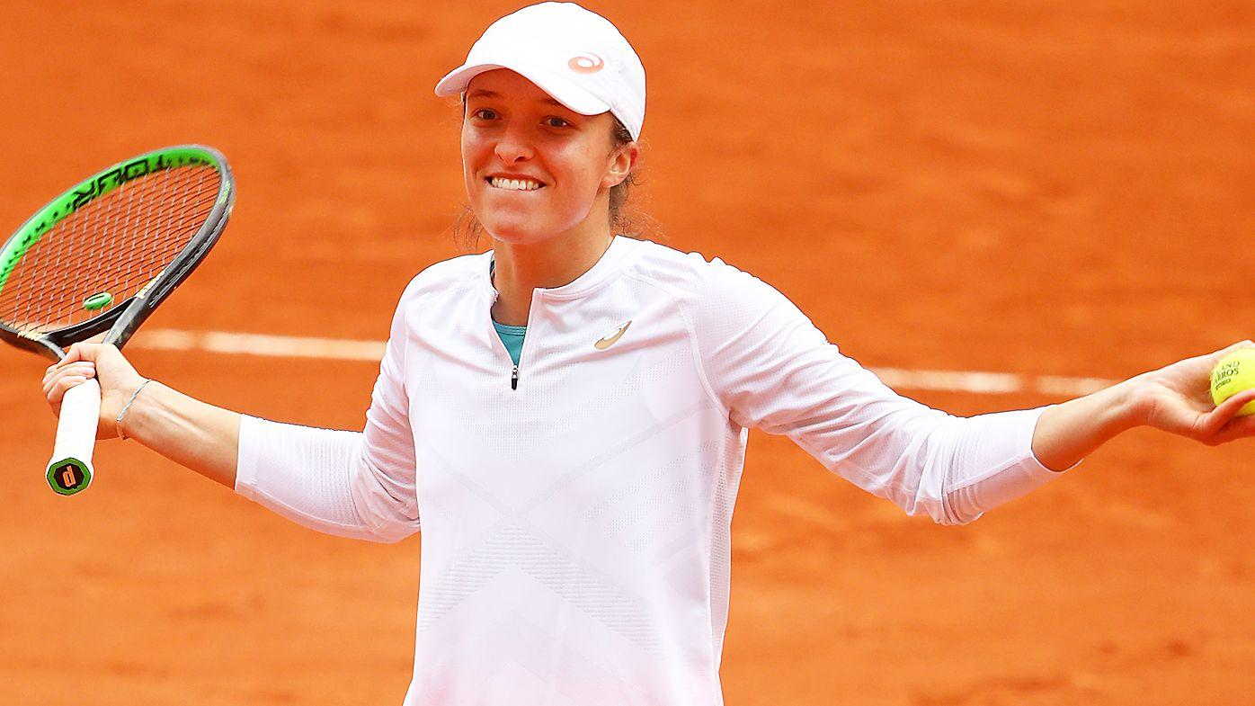 Iga Swiatek of Poland celebrates after winning match point during her Women's Singles semi-finals