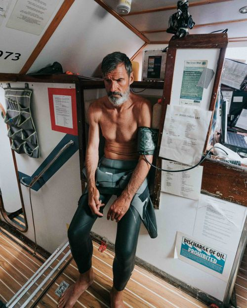 Crew monitor Ben Lecomte, on a day when he was struggling with sickness. Lecomte still swam for more than seven hours that day, before collapsing into his bed, exhausted and weak.