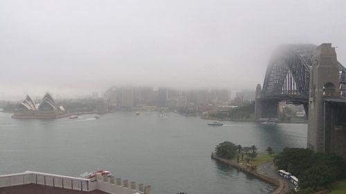 Sydney Harbour shrouded in misty rain this morning.