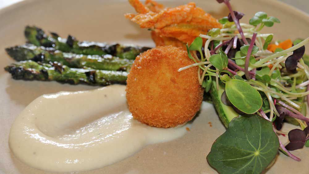 Stuffed zucchini flowers with crumbed quail eggs, garden asparagus and celeriac puree