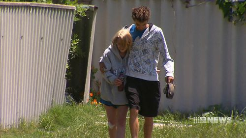 The young couple had to breakdown the backdoor to escape. (9NEWS)