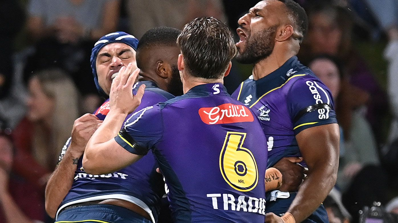 Isaac Lumelume of the Storm celebrates with team mates after scoring a try during the NRL Qualifying Final between the Melbourne Storm and the Manly Warringah Sea Eagles at Sunshine Coast Stadium on September 10, 2021, in Sunshine Coast, Australia. (Photo by Bradley Kanaris/Getty Images)