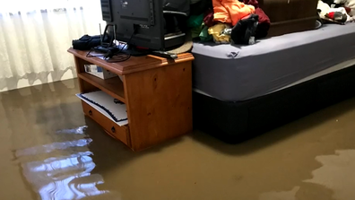The Snells rushed through their home lifting what they could from the path of the floodwater.
