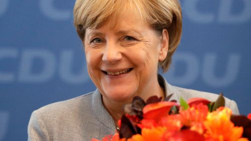 Merkel achieves coalition deal