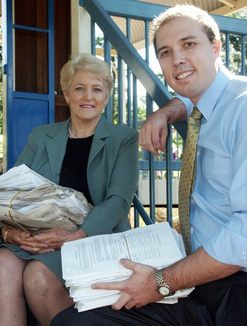 Faye Kennedy (left) and Liberal MP Peter Dutton, pictured in 2003, with 18,000 signed petitions for the modernisation of the 800-year-old double jeopardy laws. The law was reformed in 2007 and again in 2014. Picture: AAP