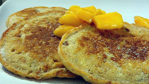Muesli pancakes with butterscotch & mango sauce