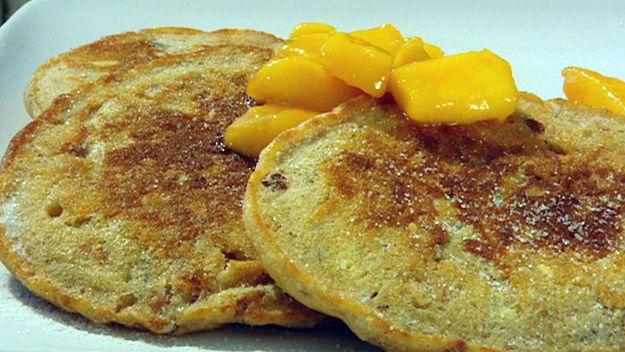 Muesli pancakes with butterscotch & mango sauce
