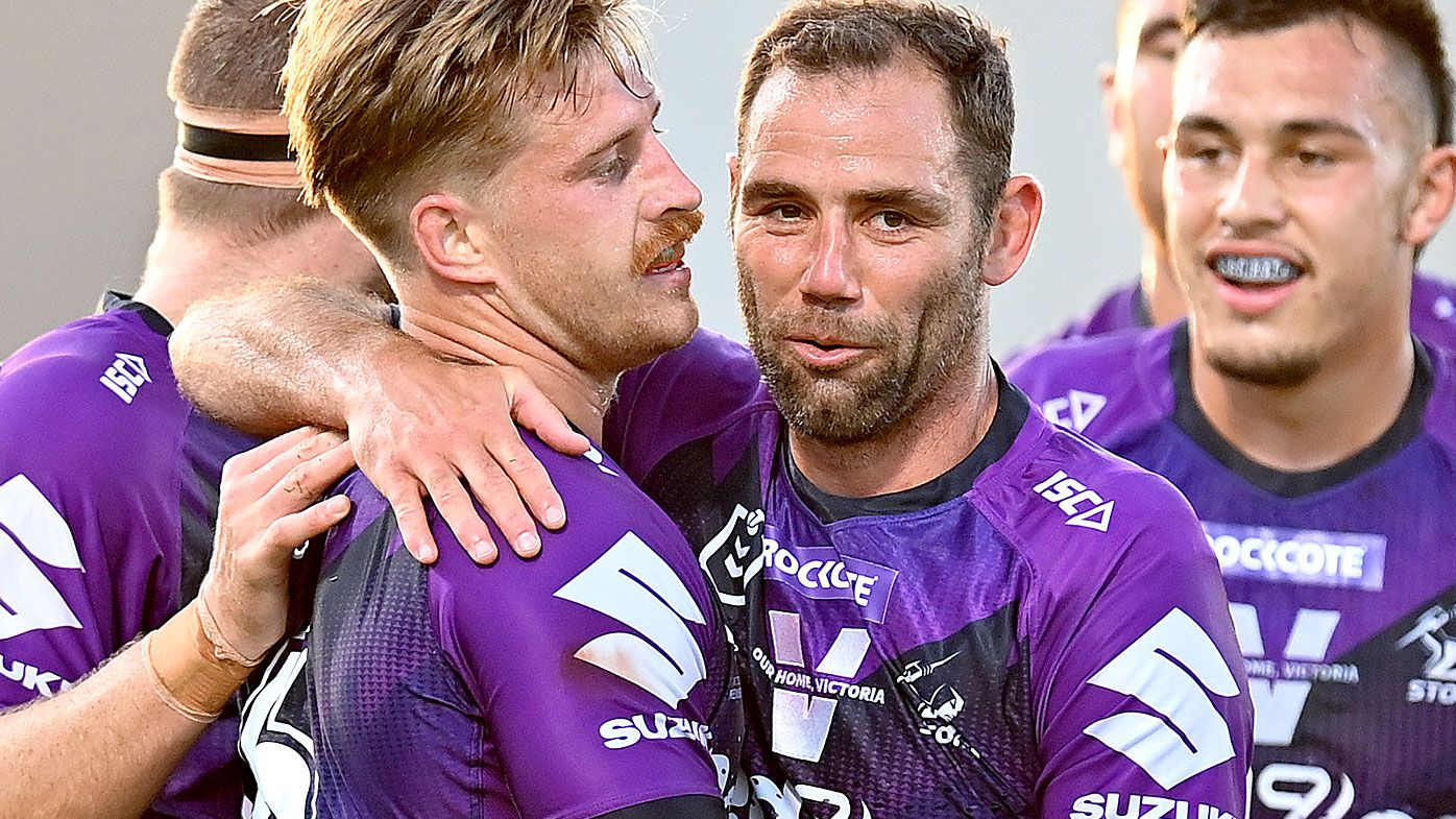 Cameron Munster of the Storm is congratulated by Cameron Smith after scoring a try