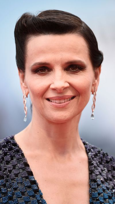 Juliette Binoche wearing Chopard earrings at <em>The Wait</em> premiere.