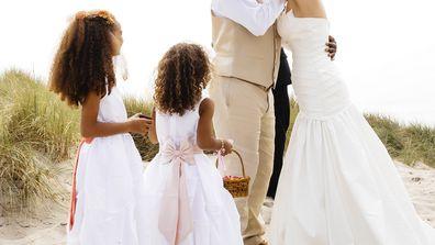 Bride and groom two children beach wedding