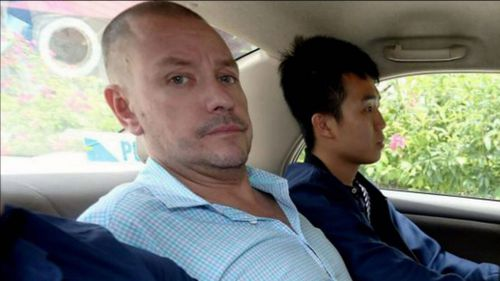 Andrew Gosling, 47, has been charged over the death of a grandfather in Singapore.
