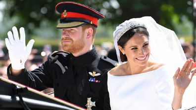 Prince Harry, Duke of Sussex and Meghan, Duchess of Sussex leave Windsor Castle in the Ascot Landau carriage during a procession after getting married at St Georges Chapel on May 19, 2018 in Windsor, England.