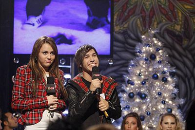 Miley Cyrus and Fall Out Boy's Pete Wentz made unlikely holiday mates while taping a 2008 MTV Christmas special.