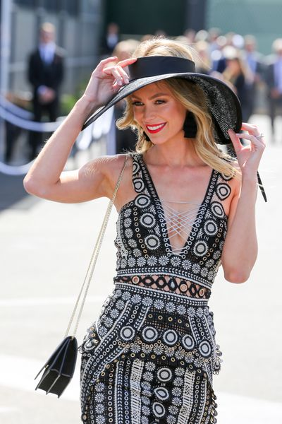 <p>No. 7. Jennifer Hawkins</p> <p>Jennifer Hawkins is a spring carnival staple and stuck to her fitted form on Derby Day in Jonathan Simkhai dress and an Ann Shoebridge hat for Myer.</p>