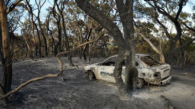 The charred remains of a car in Kersbrook as fires continue to burn through the Adelaide Hills.