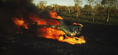 The robbers later burned their getaway car.