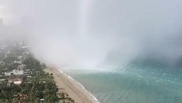 The wild waterspout formed at Golden Beach, a beach in the Miami-Dade County, Florida.
