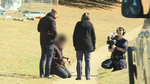 A man and his friend were assaulted by a group of three men in Jindabyne.