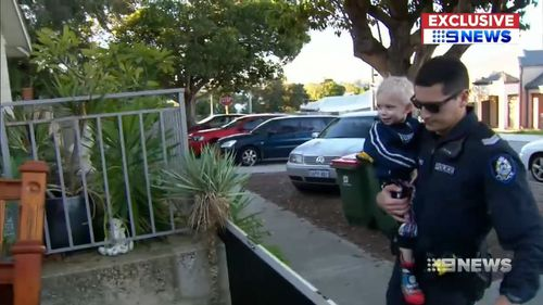 Police officers brought the boy home after the two-hour ordeal. Picture: 9NEWS