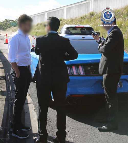 This is the moment police stopped and arrested Arsalan Khawaja in Burnett Street, Parramatta, today.