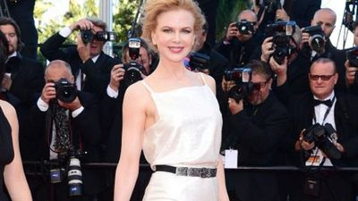 Kidman dressed in Chanel, wearing a gorgeous sequined white dress with a black and white ruffle hemline cinched in at the waist was finished with a bejewelled belt.