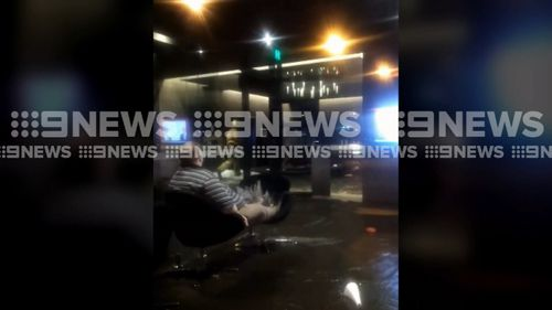 120 people were evacuated from the premises as thousands of litres of water flowed through the building and out of the front door. Picture: 9NEWS.