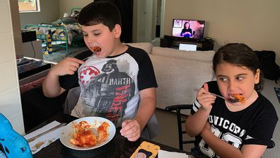 Boy with autism eating lasagne