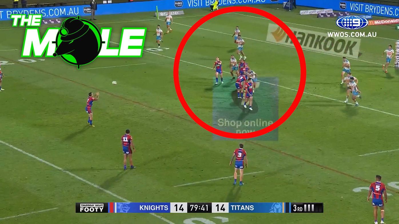 Newcastle defenders protect Mitchell Pearce as he kicks the match-winning field goal against Gold Coast.