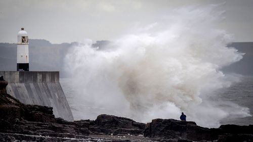 Waves hit the seafront in Porthcawl, Wales as storms lash the UK.