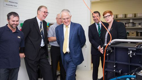 Mr Turnbull shares a laugh with managing director of Furgo LADS Corporation Mark Sinclair during a tour of the facility in Adelaide. (AAP)