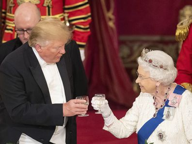 US President Donald Trump, left and Queen Elizabeth II toast, during the State Banquet at Buckingham Palace, in London, Monday, June 3, 2019.