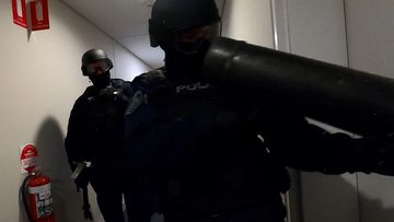 NSW Police broke down the doors at numerous apartments during the raids.