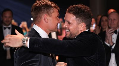 Ollie Wines, Travis Boak clasp  successful  affectional  moment