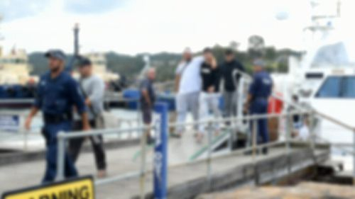 The cruise ship forcibly disembarked the alleged brawlers.