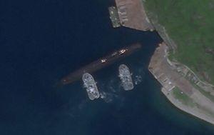 Satellite photos appear to show Chinese submarine using underground base