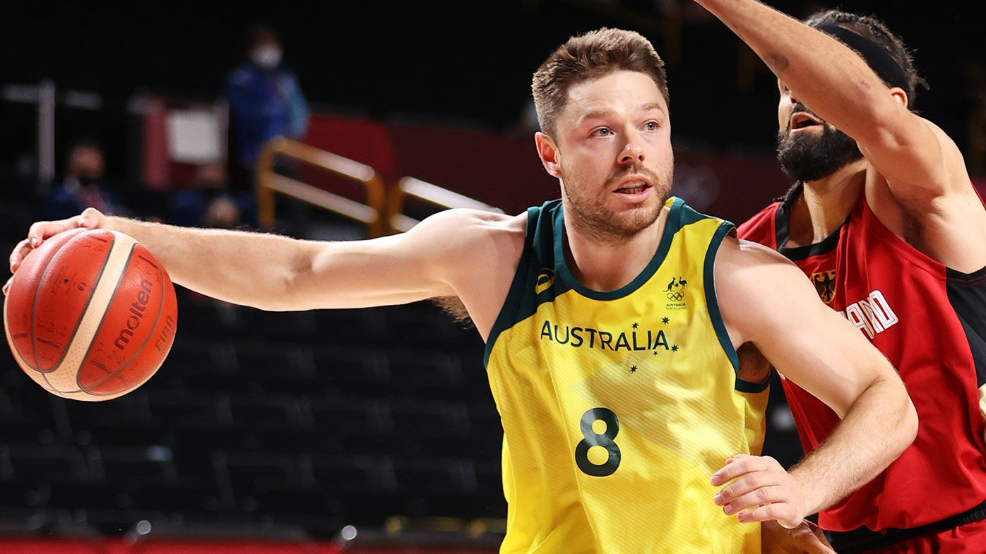 Matthew Dellavedova #8 of Team Australia drives to the basket against Joshiko Saibou #1 of Team Germany during the first half of a Men's Basketball Preliminary Round Group B game on day eight of the Tokyo 2020 Olympic Games at Saitama Super Arena on July 31, 2021 in Saitama, Japan. (Photo by Gregory Shamus/Getty Images)