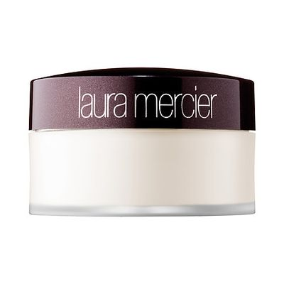 """Set your base in place. Laura Mercier translucent setting powder finishes off your base without letting it look caked on."""