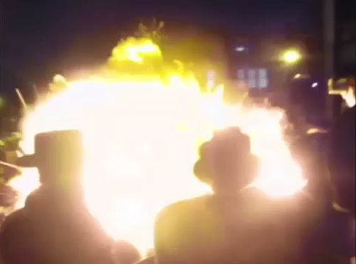 A crowd of hundreds were showered in balls of  flame as the bonfire erupted during Jewish Lag BaOmer celebrations in Stamford Hill. Picture: Supplied.
